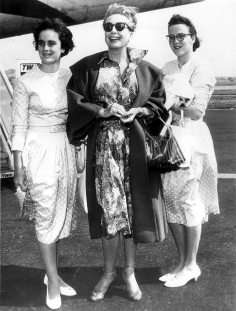 Joan Crawford, flanked by twin daughters Cathy and Cindy, at Idlewild Airport. They are about to board a plane for Los Angeles. September, 1960