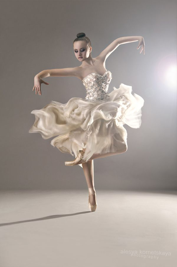 I just love the way the photographer captured the ballerina's skirt in this shot. Floaty and ethereal. And if you follow the link, check out that insane, hand-beaded corset.