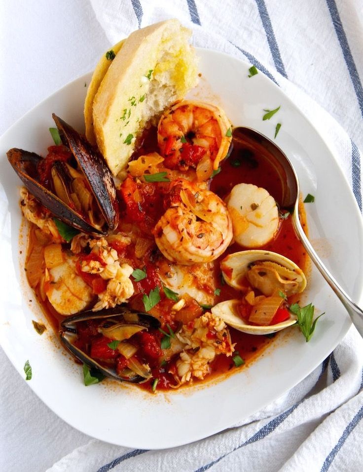-style seafood stew made with tomatoes, wine, spices and herbs ...