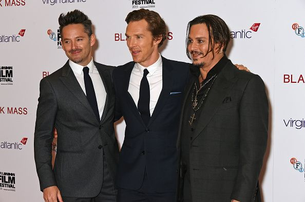 L to R Director Scott Cooper Benedict Cumberbatch and Johnny Depp attend the Virgin Atlantic gala screening of 'Black Mass' during the BFI London...