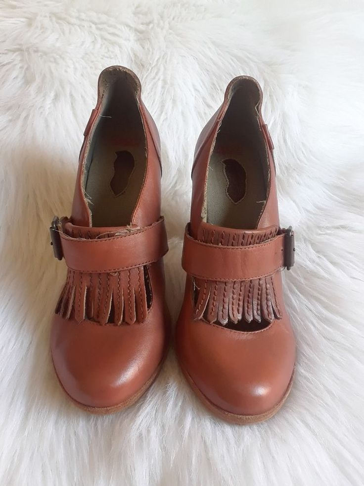 Leather upper, balance non leather, buckle style, leather fringe style and buckle strap stretches ( spandex inside strap) , light beige word Chaos on the back of the heel design. | eBay!