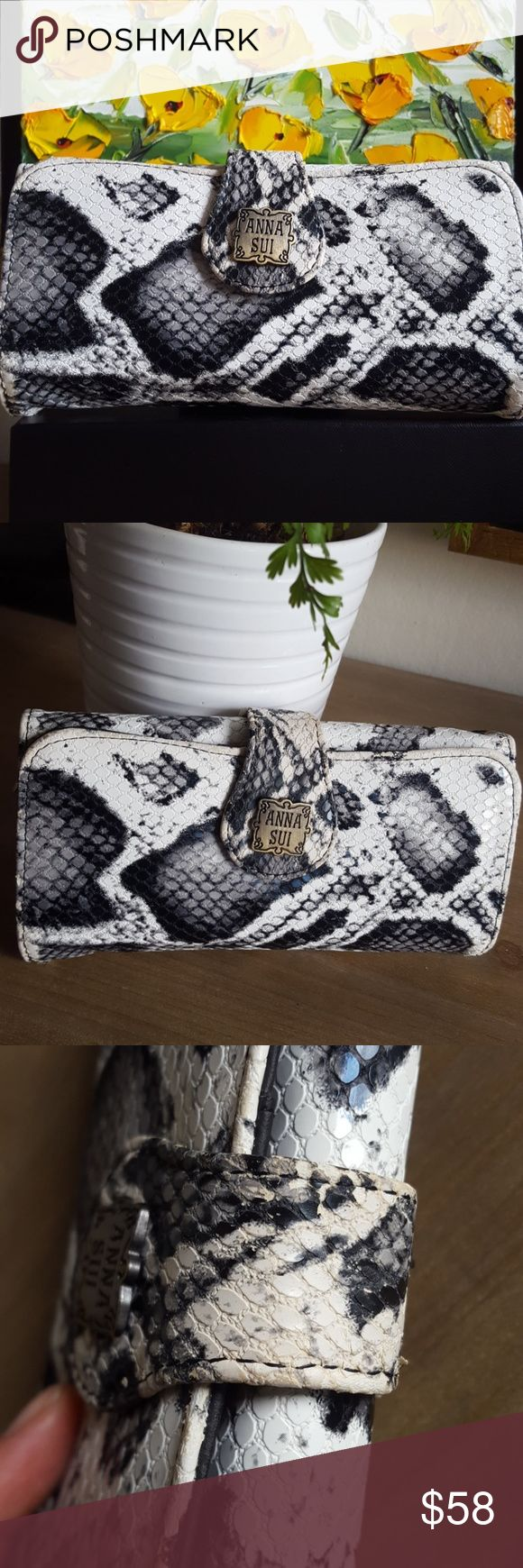 Anna Sui Python Print Wallet 🐍 Adorable black and white python print wallet from Anna Sui.  Perfect for all your everyday needs, this piece is a great companion in basic colors.  The inside is made of a thinner nylon to keep a low profile, and will keep your ID safe in sight.  Slight signs of wear at opening tab, and small flecks of the white finish apparent inside, though the wallet is unused.  Super cute! Anna Sui Bags Wallets