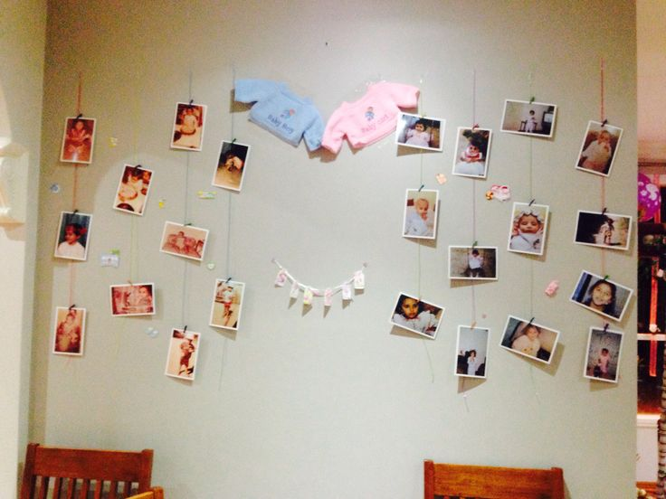 Wall decor with to be mommy and dads childhood pics with some adorable baby shower stickers..