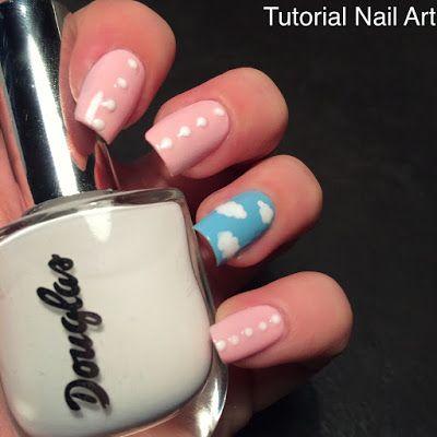 Unghie tutorial nail art rosa con nuvole bianche e pois, realizzato con il dotter per la primavera.