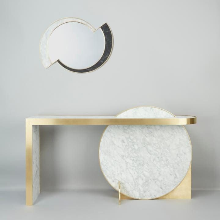 The Collision Console in carrara marble and brushed brass and Half Moon Mirror in nero marquina, carrara marble and brushed brass by Lara Bohinc for Lapicida is part of the ongoing Lunar Collection, £15,540 and £4,200 respectively, Lapicida