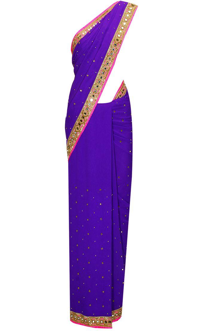 Indigo salli and mirror work sari with bright pink embroidered blouse by Arpita Mehta. Shop now: http://www.perniaspopupshop.com/designers/arpita-mehta #sari #arpitamehta #shopnow #perniaspopupshop