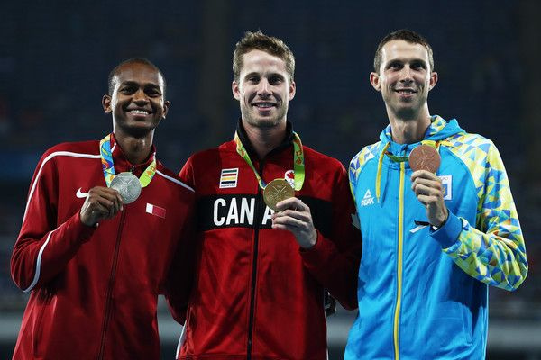 (L-R) Silver medalist Mutaz Essa Barshim of Qatar, gold medalist Derek Drouin of Canada and bronze medalist Bohdan Bondarenko of Ukraine pose on the podium during the medal ceremony for the Men's High Jump Final on Day 12 of the Rio 2016 Olympic Games at the Olympic Stadium on August 17, 2016 in Rio de Janeiro, Brazil.