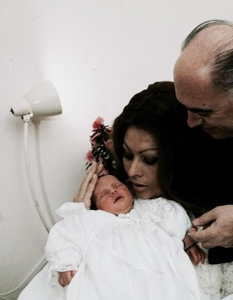 Sophia Loren and Carlo Ponti with their newborn son Carlo Ponti Jr., 1968. Photo by Francois Gragnon.