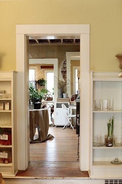 Cream bookshelves & trim against butter yellow walls