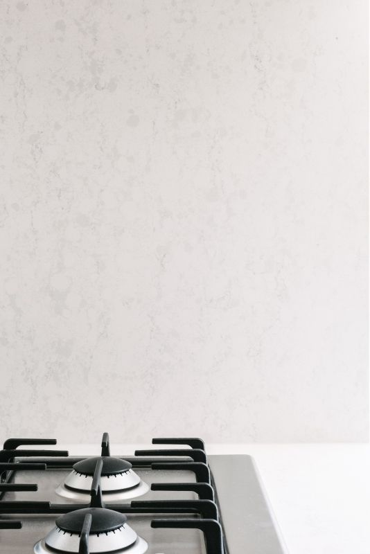 Straight-Laced house by windust architecture + design. A reconstituted stone finish for kitchen splashback.