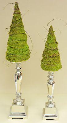 Kerstboompjes op kandelaar