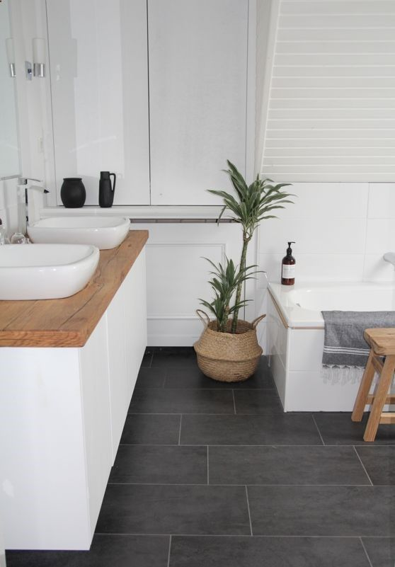 our new bathroom: i like the combination of cold elements like white walls and grey floor with warm elements like wood and plants