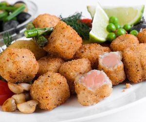 Fried salmon nuggets is excellent appetizer.Breaded fresh salmon cubes with herbes and Parmesan cheese fried in olive oil.