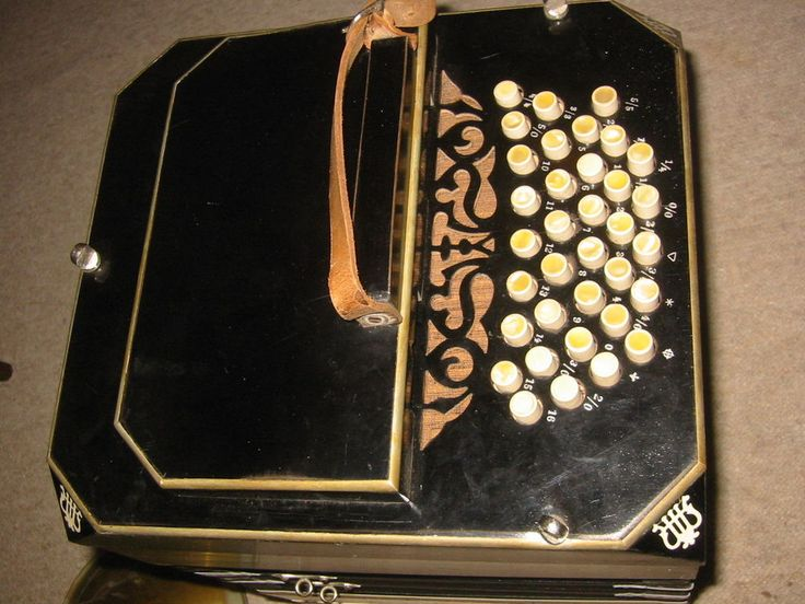"""Very nice old diatonic concertina or bandoneon. It has 35 buttons on one side and 37 buttons at the other side. It reads """" ELA"""" (Ernst L. Arnold) inside. 