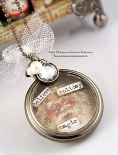 Tim Holtz pocket watch [http://www.creationsceecee.com/2011/12/a-christmas-necklace-from-tim-holtz.html]