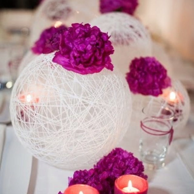 Wrap balloon with string, spray with fabric hardner, pop balloon. Amazing center pieces.
