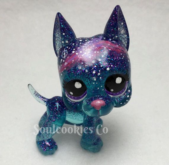 A custom resin Littlest Pet shop Great Dane with a Galaxy theme. He was painted with high quality acrylics then sealed with a super shiny sealer. He