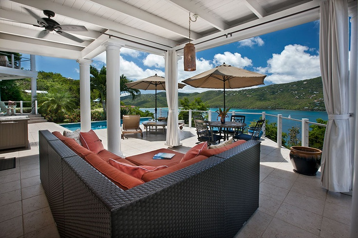 The outdoor patio features that soothing sea vista and green hills of St. Thomas beyond; comfortable, cushioned seating and alfresco dining make this spot a favorite. The tiled deck continues to the infinity-edge pool, set with chaise lounges for reading while working on your island tan.