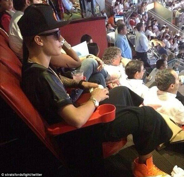 Sports fan: Justin and his mystery woman were among the crowd for Game 7 of the NBA Finals on Thursday night between the San Antonio Spurs and Miami Heat in Florida