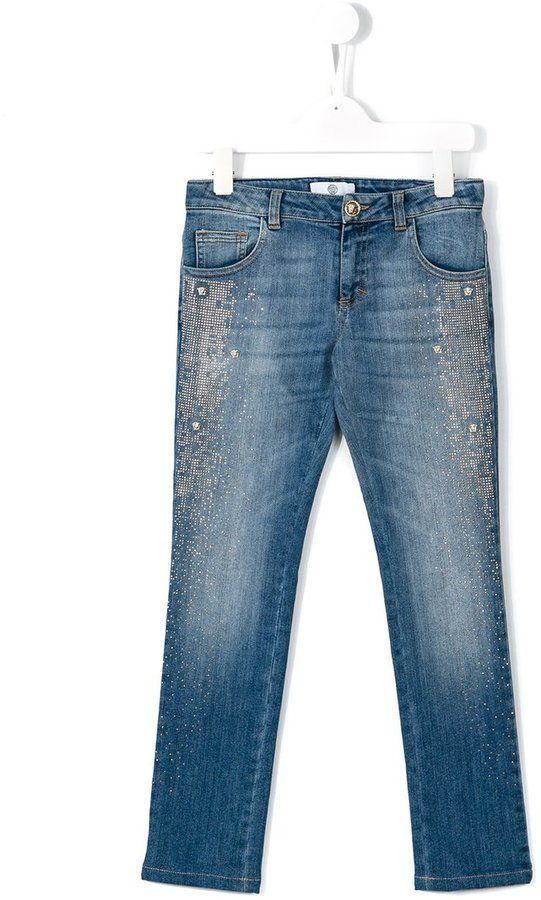 Versace Medusa studded jeans