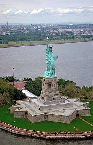 Statue of Liberty - New York City                 Visit Ellis Island, and go to the top of the Statue of Liberty
