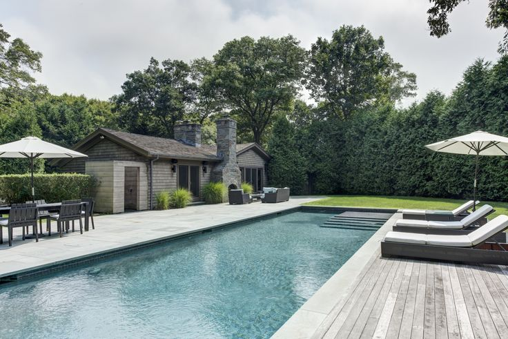 The piece de resistance is the gorgeous backyard of this East Hampton home which has a spectacular heated, gunite, saltwater pool, an outdoor shower, and a generous blue stone patio with a wonderful outdoor fireplace.  For a tour speak to Tracy Annacone, Licensed Real Estate Salesperson, 631.324.8080.  #outdoorliving #pool #poolhouse #cabana #househunting #milliondollarlisting #easthampton #homeforsale #hamptonsrealestate #hamptonsliving #summerhouse