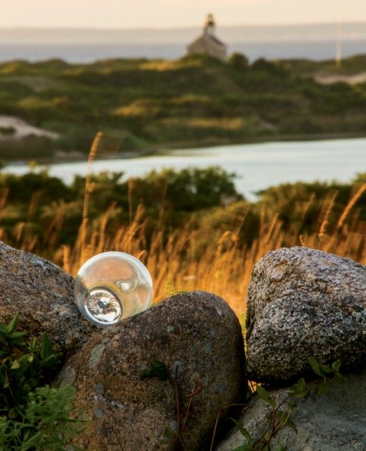 A float is hidden in a stone wall at the Hodge Family  Wildlife Preserve, overlooking Block Island's historic North Light.