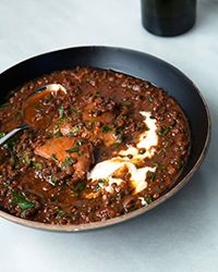 The Ethiopian spice blend called berbere adds delicious warmth to this black lentil and chicken stew.  Use Le Creuset instead of slow cooker