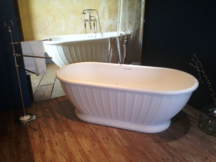 Albany freestanding bath in natural stone with Arcade freestanding bath shower/mixer taps