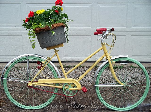Garden Art Bike.....I just love the red flowers and the red pedals and handlebars!