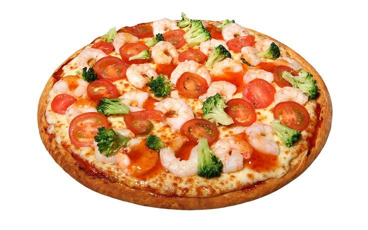 Capricciosa (Szynka, Jajko, Pieczarki, Pomidor, Oliwki , Ser Mozzarella, Sos pomidorowy)