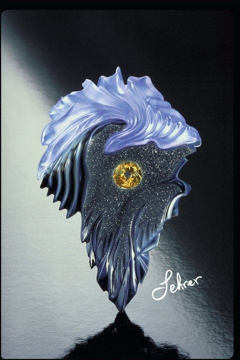 Award winning Gem carving by Glenn Lehrer- 1st place Award winner at AGTA.  (American Gem Trade Association) featuring a Torus Ring Cut (TM) Montana   Golden Sapphire in the center, surrounded by a custom carved Black Drusy Agate, with a custom cut African Blue Chalcedony on top. No glue was used; a tongue and groove technique that screws together and apart.