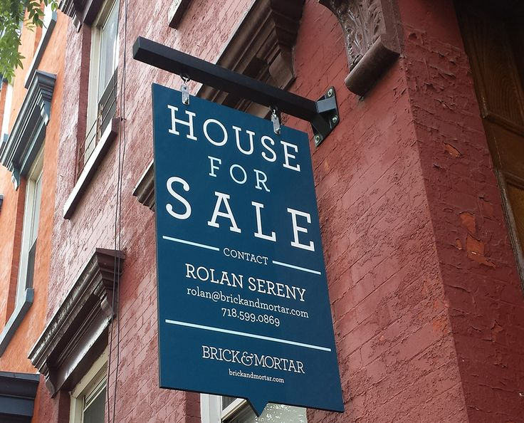 Brick & mortar real estate sign