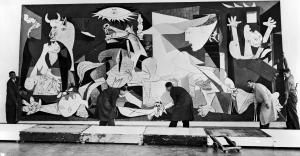 Why is Picasso's Guernica Painting So Famous?: Guernica in Amsterdam, being hung in the Municipal Museum 12th July 1956