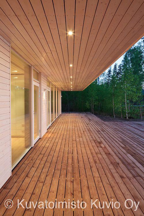 Wooden terrace. Plushuvila is a villa in Mäntyharju, Finland. It's designed by Plusarkkiethdit.