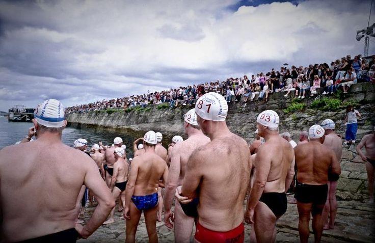 The annual harbour swim starts at the east pier and contestants swim around the harbour.  August 2008 - David Gray