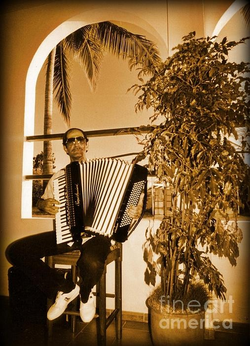accordion player here is an antique himself LOL awesome photo
