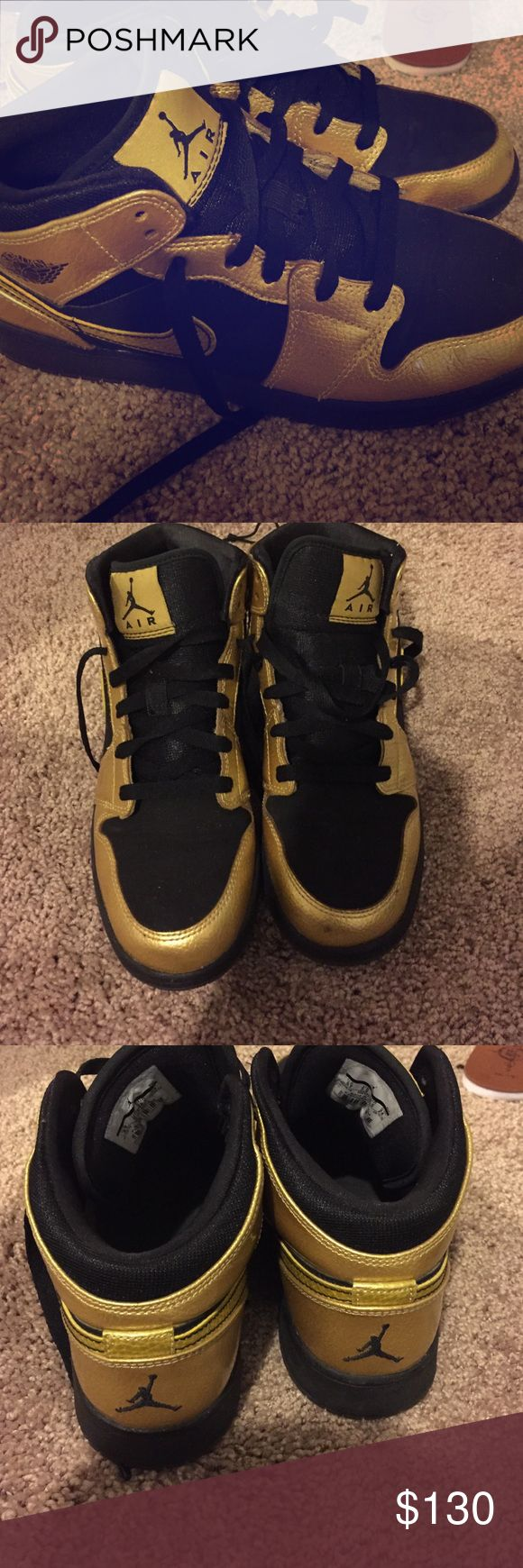 Black and gold rare Jordan 1's Black and gold jordan 1's. Used but in good condition just small scuff on front that can be fixed or buffed..size 6 in boys women 8 Jordan Shoes Sneakers