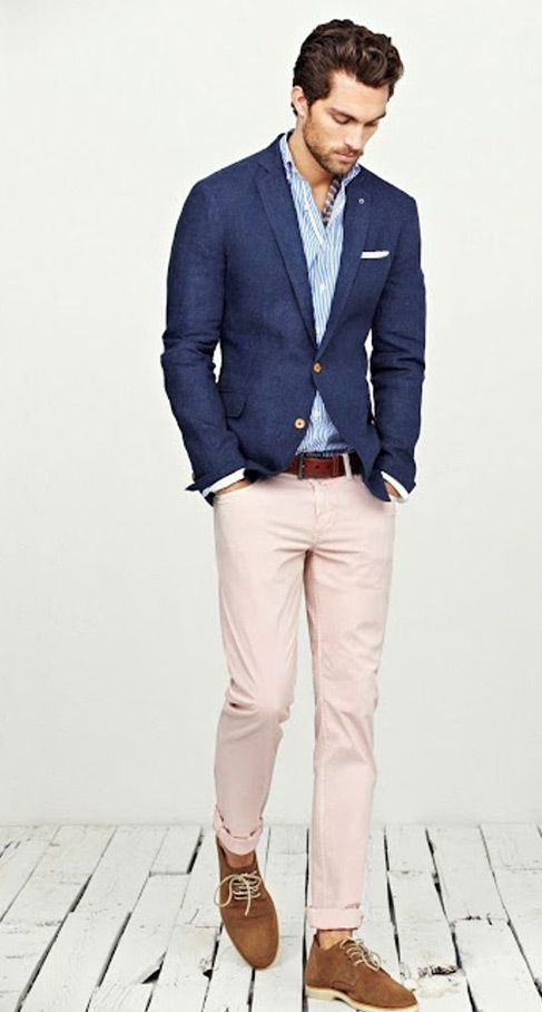Navy blazer, light blue oxford shirt, and beige slacks with brown belt, brown shoes, and a white pocket square.