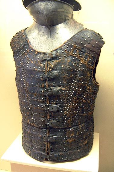 Brigandine, leather, Paris, late 1400's | Flickr.   Unlike armour for the torso made from large plates, the brigandine was flexible, with a degree of movement between each of the overlapping plates. The rivets, or nails, attaching the plates to the fabric were often decorated, being gilt, or of latten, and sometimes embossed with a design. Medieval brigandines were essentially a refinement of the earlier coat of plates, which developed in the late 12th century.