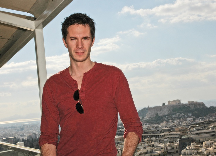 Apollo on Mt. Olympus?  Not quite..  James on the roof of the hotel St. George Lycabetus (Jan. 2011).  (very large pic)