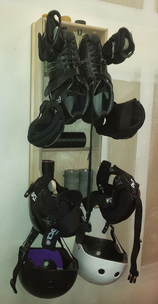 Roller Derby Gear Rack Mounts On The Wall To Hold And Dry