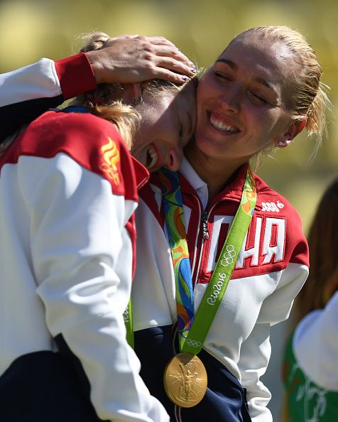 Gold medalists Russia's Ekaterina Makarova and Russia's Elena Vesnina hug as…