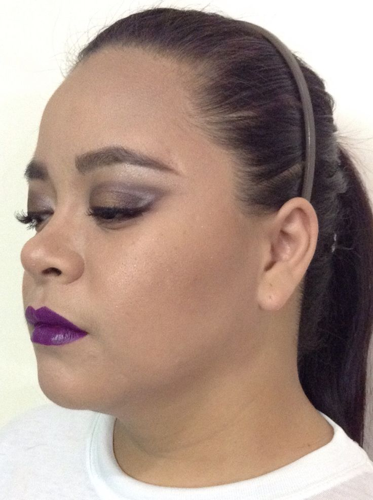 Dramatic smokey eyes with a twist and a pop of color on the lips
