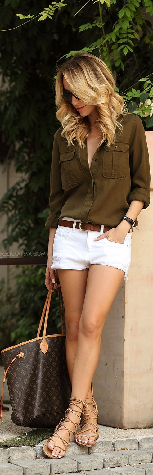 Khaki shirt, white shorts, gladiator sandals. Great fashion for summer.