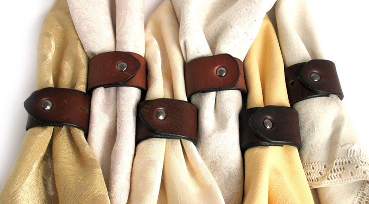 Repurposed Belts as napkin rings...wearable Western party favors for each guest to remember your big day...<3 it! ~Your local leather store can make these the right size for a wrist cuff and add the snaps for you~
