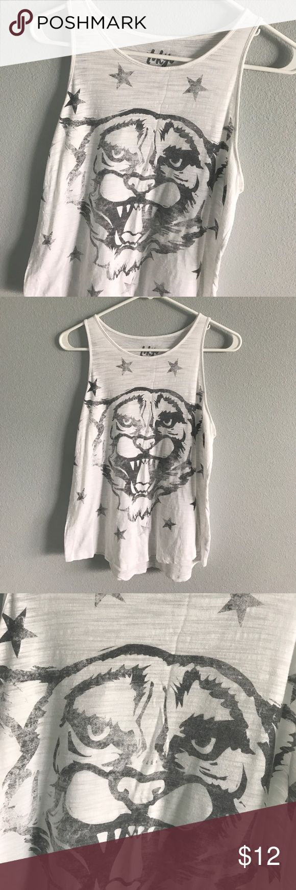 Graphic tiger tank Tokyo Darling Aeropostale Cute light weight graphic tank with a faded tiger and stars on it. Slight high low hem, hits around hips. Fabric is slightly see through. Small amount of pilling near armpits but no stains or holes. Tokyo Darling for Aeropostale. Aeropostale Tops Tank Tops