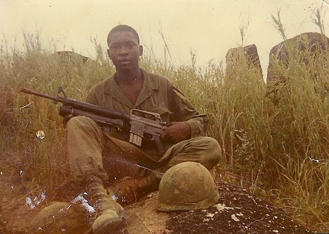 A soldier from the 1st Cavalry Divison (Airmobile) poses with his M16 ~ Vietnam War