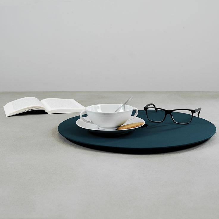 POSATO is a handy powder painted black matt iron coffee table that comes with a useful removable wooden tray painted with a delicate but intense nuance.