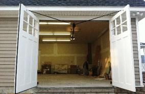 Automatic Openers for Swing Out Carriage House Garage Doors